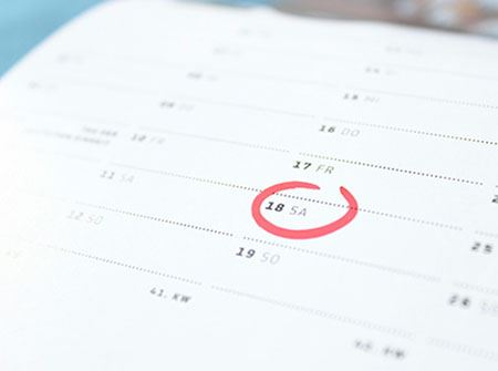 A calendar with a date circled in red