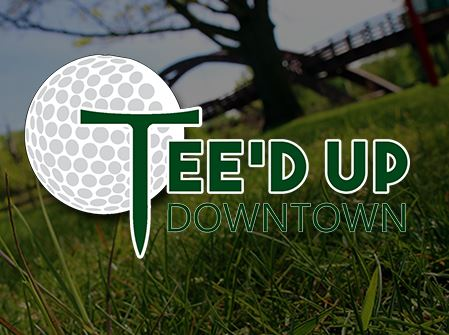 A Teed up Downtown logo on a shot of the Tridge
