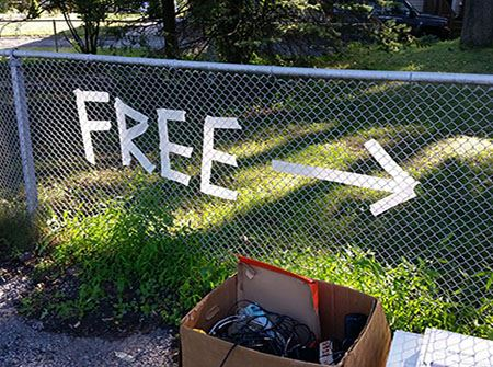 "A chain link fence with ""free"" written on it in tape"