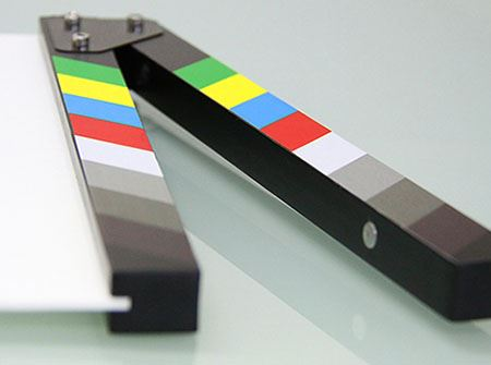 A multi-colored director's clapboard