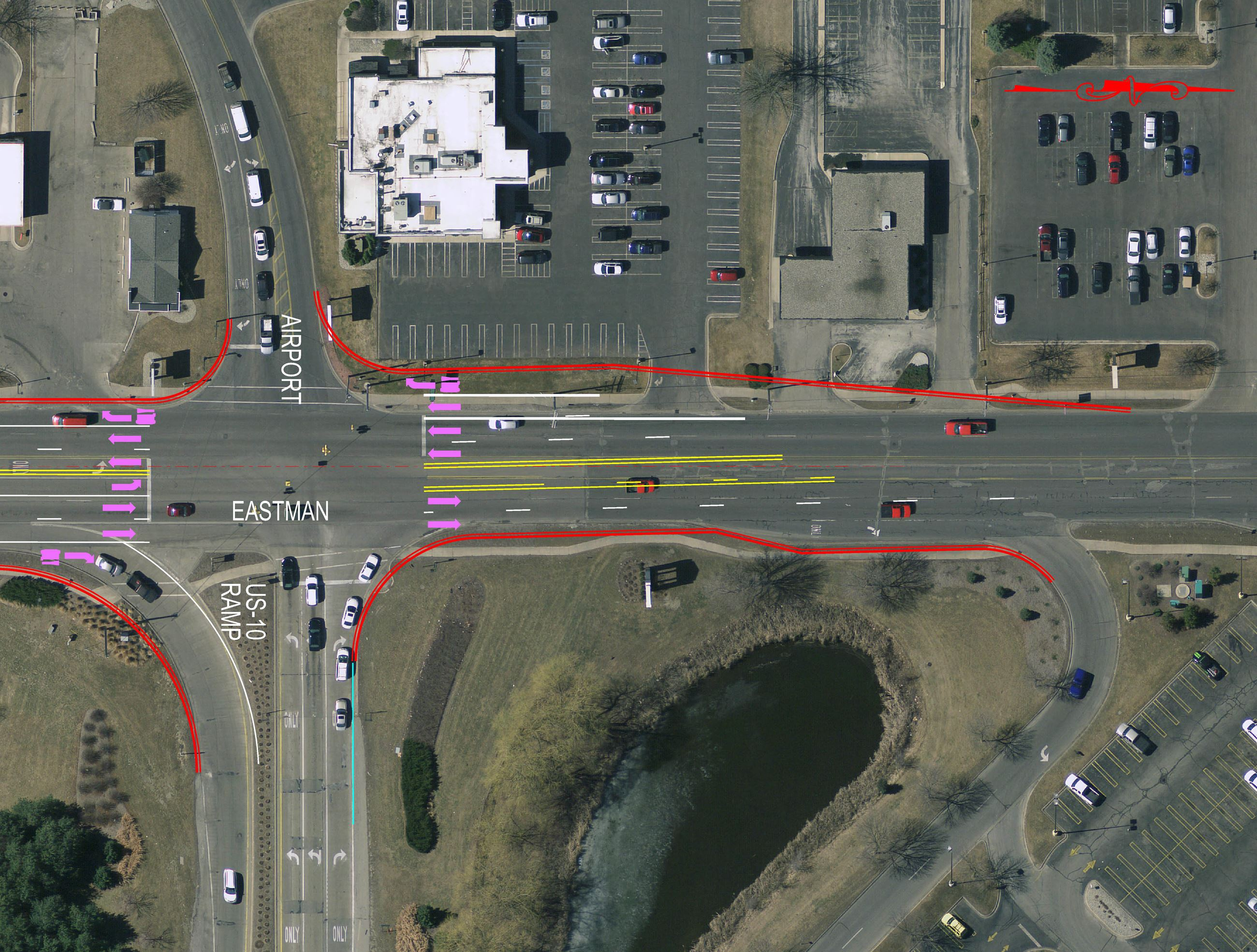 An aerial view of Eastman Avenue at Airport Road with colored delineations for turn lanes