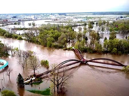 The Tittabawassee Ribver floods the Tridge area in downtown Midland
