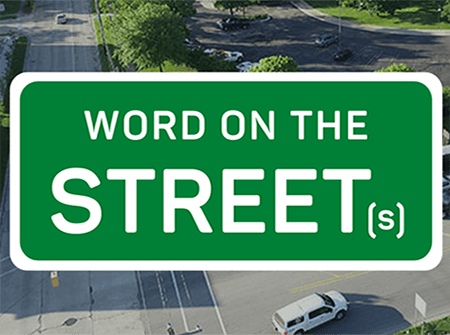 An aerial photo of Buttles Street with a green graphic that says Word on the Streets over it