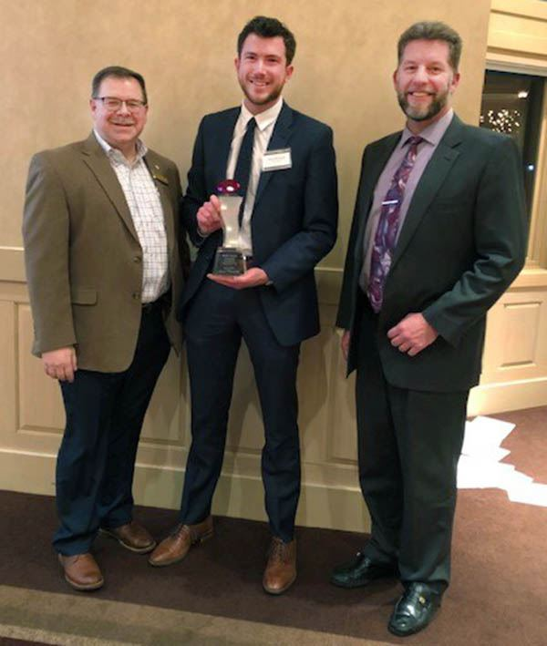 Grant Murschel (center) with his RUBY Award