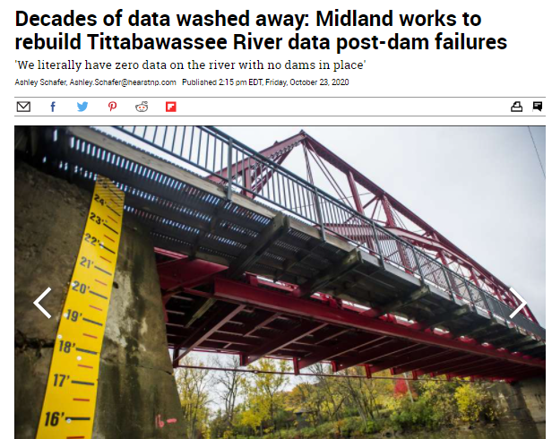 A screenshot of a Midland Daily News article showing a red bridge with measuring stick Opens in new window