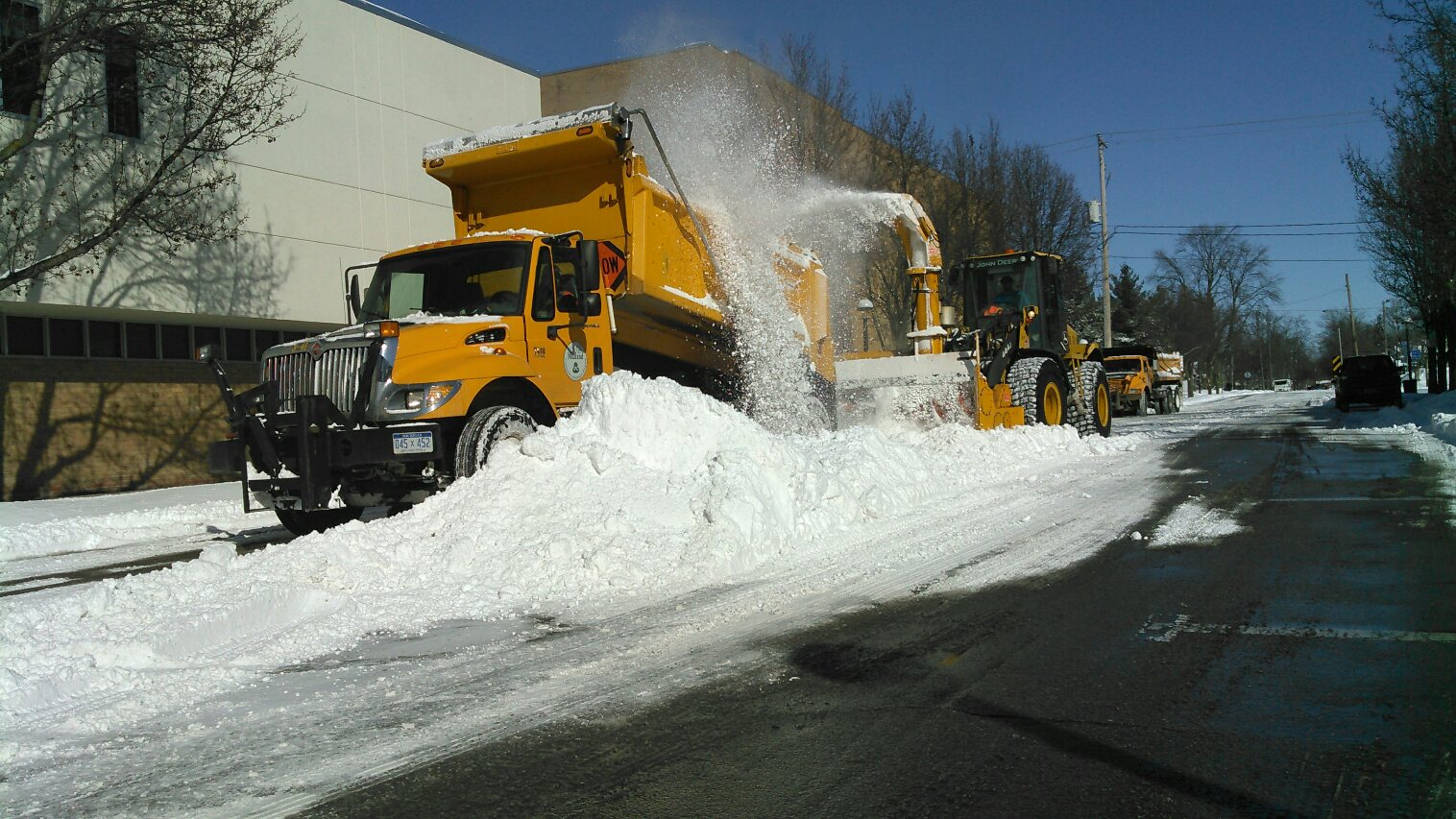 Snow Removal Downtown trucks on road